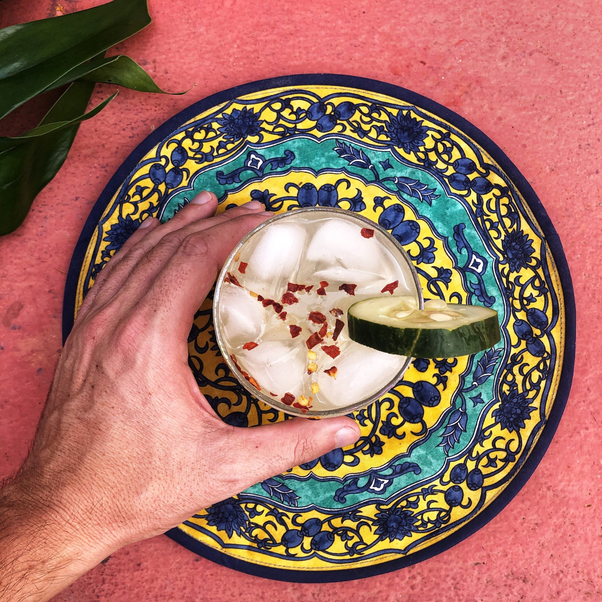 person holding blue and white ceramic bowl with ice cream